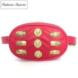 Stock limité - Sac ceinture ovale avec décoration dorée