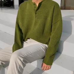 Green buttoned sweater