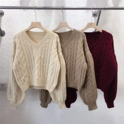 Twisted sweater with puff sleeves