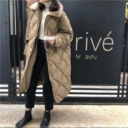 Long manteau matelassé avec col en fourrure