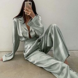Green satin shirt and flared pants set