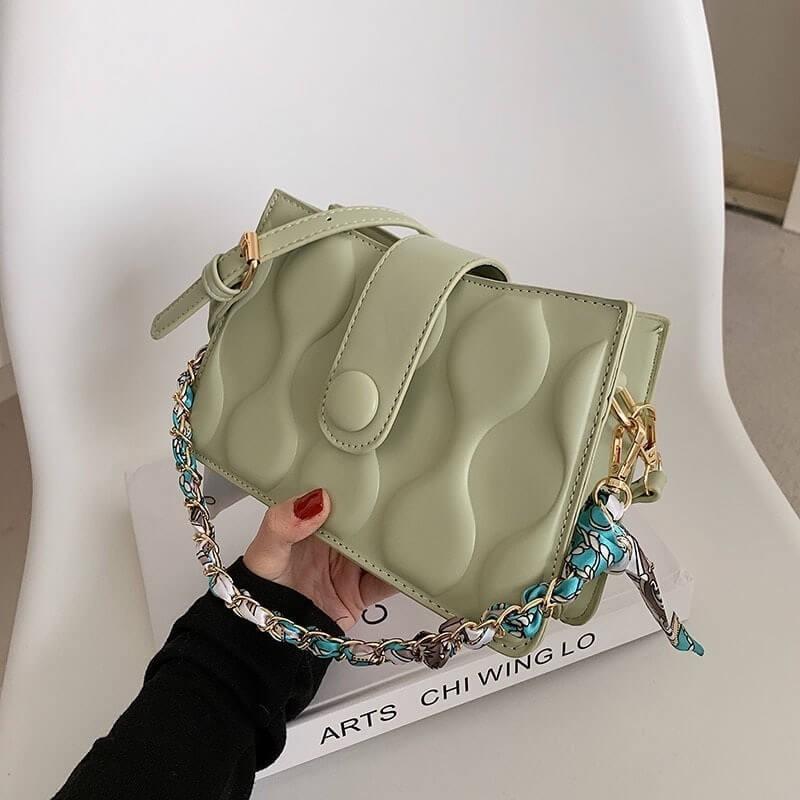 Retro design handbag with scarf on the handle