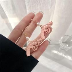 Pink gun earrings