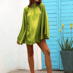 Fluid green dress with open back