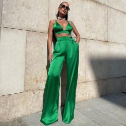 Green satin crop top and wide pants set